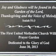Plaque at entrance of garden